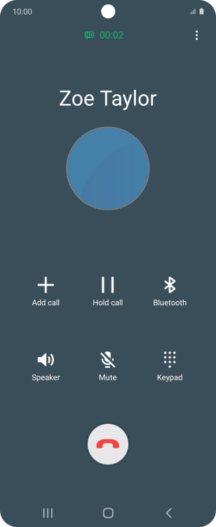 Press the end call icon.